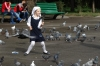 Children chasing pigeons outside Zenkov Cathedral