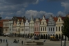 Colorful houses with arcades and ornamental gables ring Zachariáš of Hradec Square