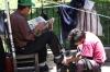 Shoeshining. Market day in Chichicastenango