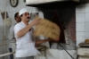 Making stone bread (the bread is cooked on blue metal). Kashan Historic Bazaar