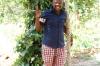 Our guide under a clove tree, Kidichi Spice Farm, Tanzania
