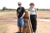 At a cairn marking the border of the Serangetti, Tanzania & Masaimara, Kenya