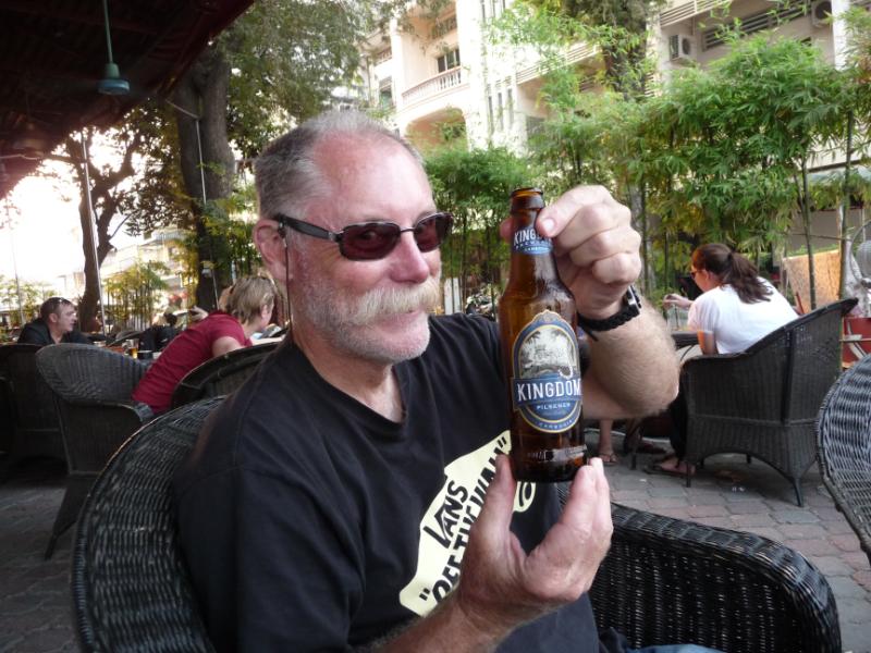 "Bruce enjoying Cambodian ""Kingdom"" beer"
