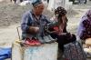 Shoe repairs. The market, Shakhrisabz
