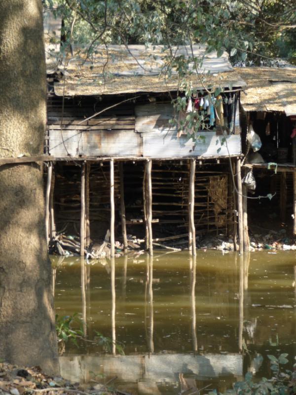 Stilt houses on Siem Reap River near River Garden