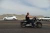 Biker passing Yellow Mounds Overlook, Badlands SD