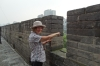 Thea pointing west to the Silk Road from the ancient city wall od Xi'an