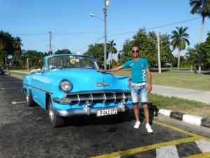 Owen and his 1954 Chevrolet ride through Havana, Cuba